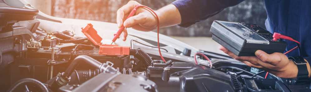 Mechanic checking over car as part of a regular service - Car Servicing Southampton